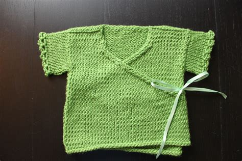 knitting pattern explained a sling and a baby sweater and looking knooking