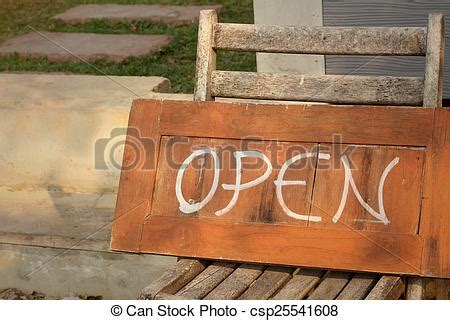 what does wood symbolize stock photography of signs symbolize open on a wood