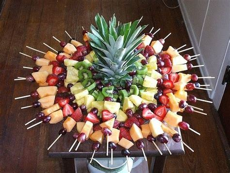 Fruit Skewers Stuck In A Pineapple Awesome Appetizer Fruit Kabob Centerpiece