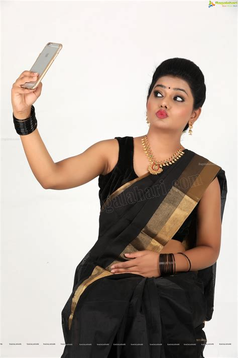 Black Sleeveless Blouse With Saree by Sumaya So Beautiful In Black Sleeveless