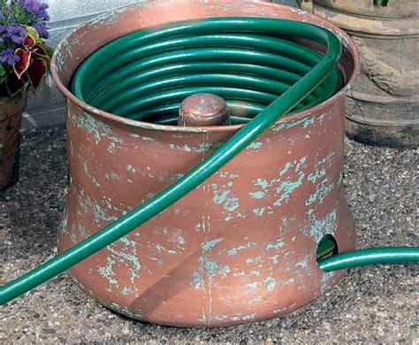 garden hose container storage 18 creative ways to store your garden hose garden