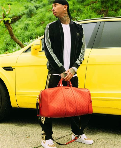 tyga yellow bentley asap rocky wears balenciaga jacket pack calvin