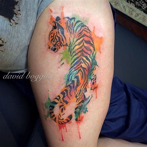 watercolor tattoo of crawling tiger on leg tattoos
