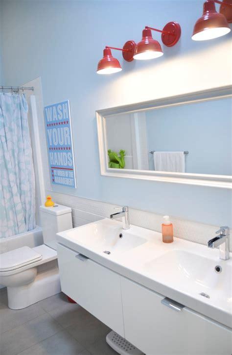 barn light bathroom barn wall sconces add splash of color to boys bathroom