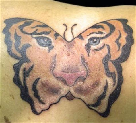 butterfly tattoo tiger eyes tiger eyes on butterfly tattoo tattooimages biz