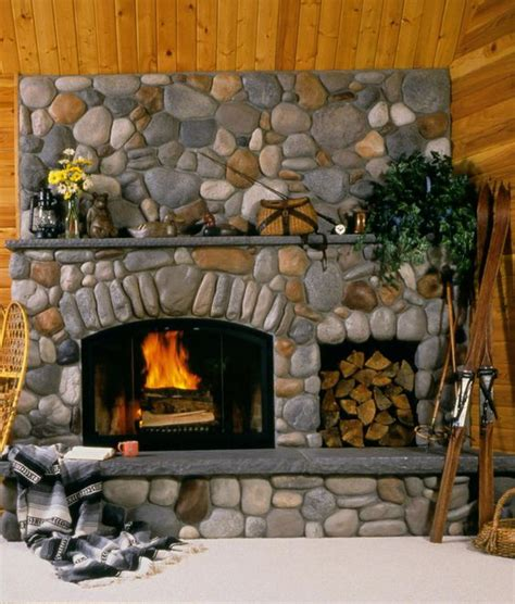 25 stone fireplace ideas for a cozy nature inspired home river rock always makes a pretty fireplace 25 stone