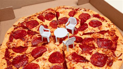 table small pizza canadian eatery puts tiny chairs around the table