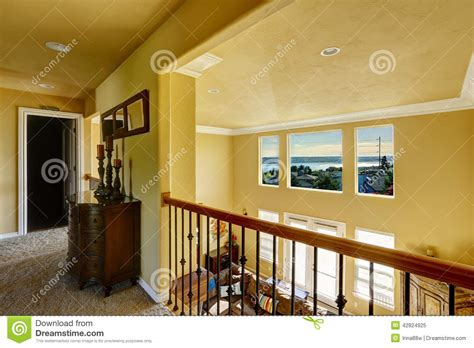 house design living room upstairs upstairs hallway overlooking living room stock photo