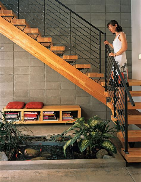 how to make an indoor fish pond dwell indoor fish pond viewed from rich wooden staircase interior design ideas