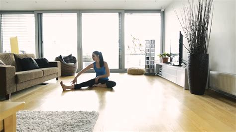 living room yoga beautiful young woman working out at home in living room