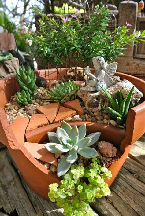 garden in a flower pot broken flower pots make whimsical gardens