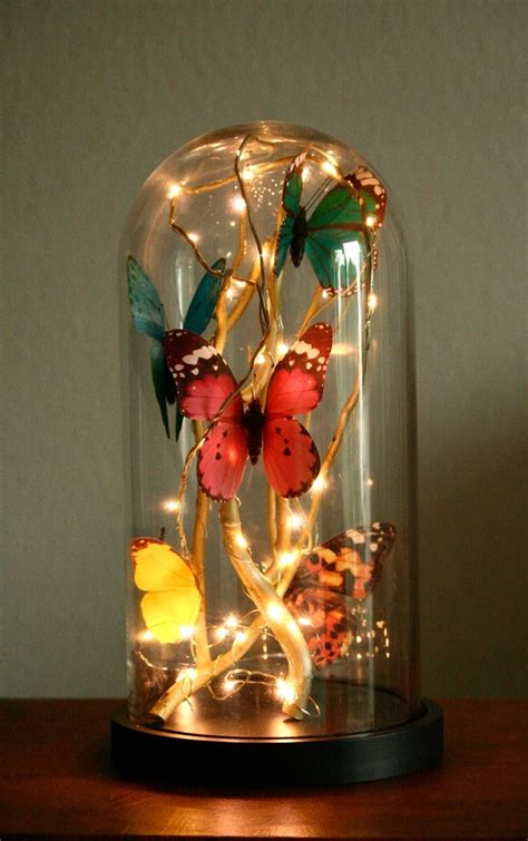 how to make lighted branches how to make a glass cloche filled with butterflies fairy
