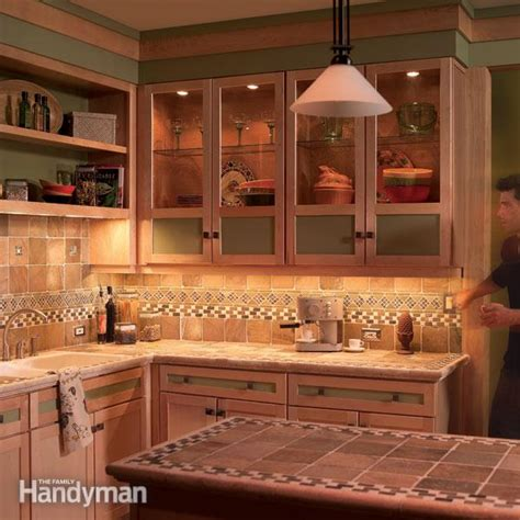 cabinet lighting in kitchen how to install cabinet lighting in your kitchen the family handyman