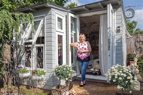 woman creates luxury mini mansion   garden shed