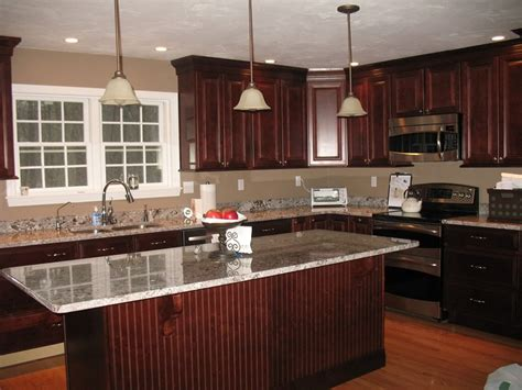 granite with cherry cabinets in kitchens bianco romano granite for kitchen and bathroom