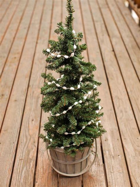 outdoor holiday decorating idea mini christmas tree