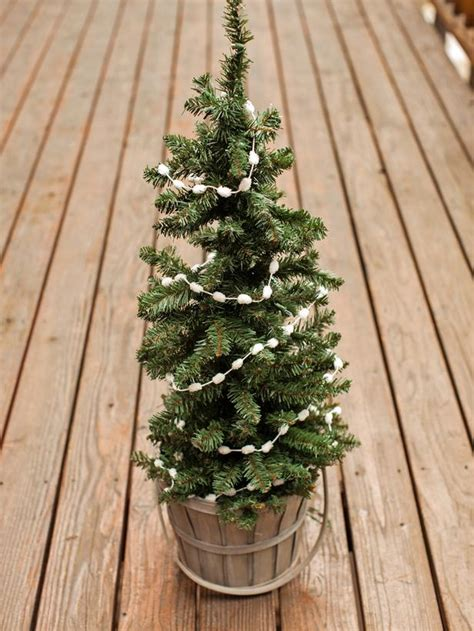 outdoor holiday decorating idea mini christmas tree