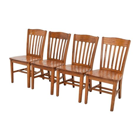 71 four brown slat back wood chairs chairs