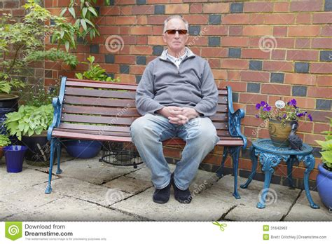 sitting on bench man sitting on a bench stock photos image 31642963