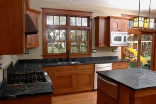 interior designs black marble countertop wooden cabinets
