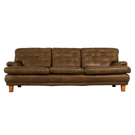 three seat sofa with green leather by arne norell for sale