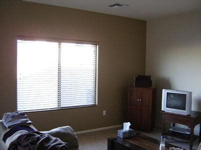 brown accent wall in living room we painted a brown statement wall in our living room