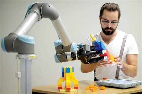 film with robot teachers robot learns to play with lego by watching human teachers