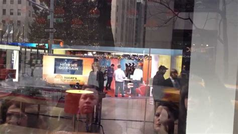 today show orange room orlando bloom looking at phone at today show orange room in nyc before promoting the hobbit