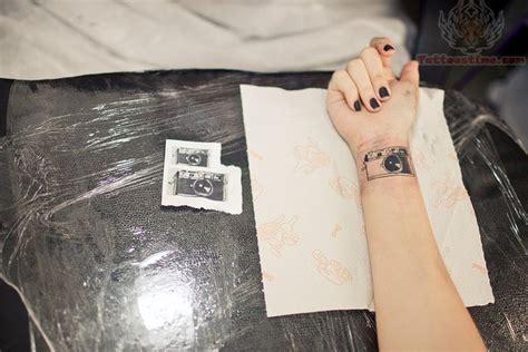 camera wrist tattoo wrist