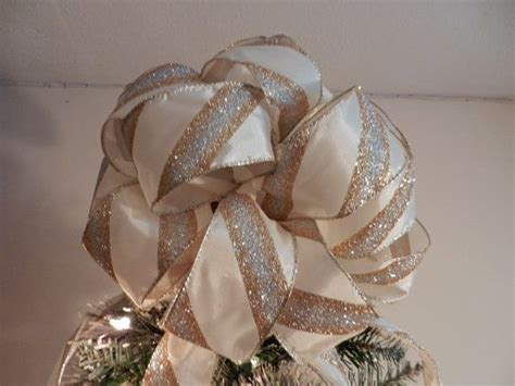 how to make a large tree topper bow large tree topper bow made of an ivory ribbon with gold and silver glitter stripes