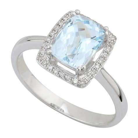 9ct white gold and blue topaz dress ring