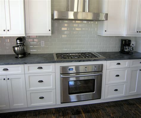 Island Style Kitchen by White Kitchen With Stove Hood Schoeman Enterprises