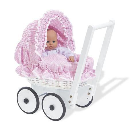 ouderwets buitenspeelgoed houten speelgoed meisjes jongens poppenwagen