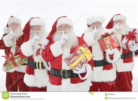 imagenes de santa claus para hombres grupo de hombres vestidos como santa claus holding gifts