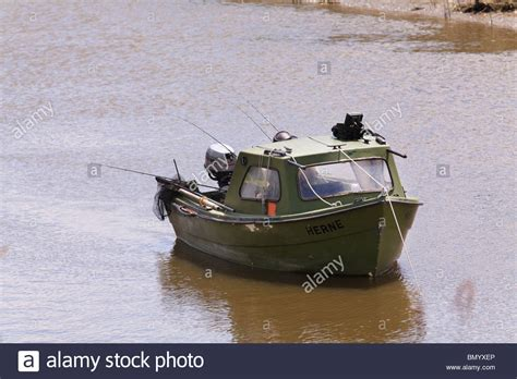 small boat with motor small motor fishing boat with one fisherman and many