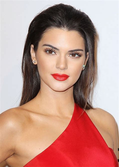 womans face at angle hair slicked on white stock photo kendall jenner s perfect red lip plus more celeb beauty