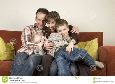 couch family family on a couch 3 royalty free stock photos image 4173948