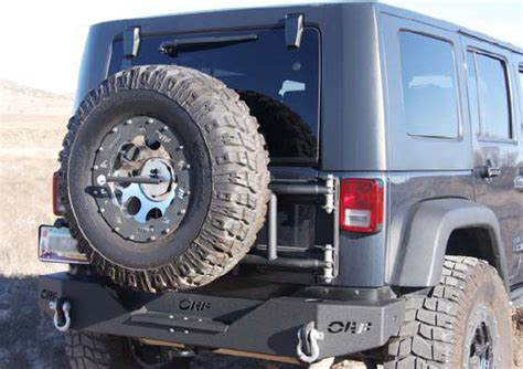 fab swinge or fab swing a way tire carrier for 07 13 jeep 174 wrangler