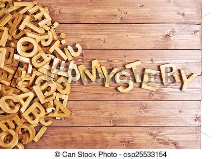 stock images of word mystery made with wooden letters