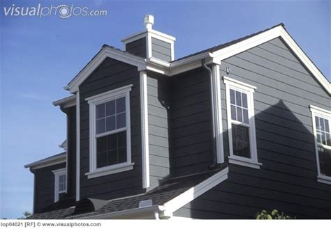 houses with black roofs dark grey fiber cement siding with white trim and black roof exterior house colours