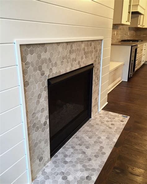 love this hex mosaic tile fireplace surround chenille