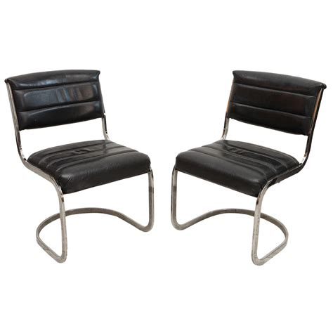 Black And Chrome Dining Chairs Set Of Four Ribbed Black Leather And Chrome Cantilever Dining Chairs At 1stdibs