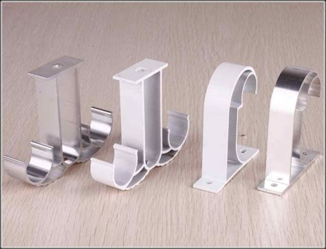 installing curtain rod brackets how to install ceiling mount curtain track john robinson