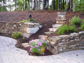 old world retaining wall and patio eclectic landscape raleigh by shannon hathaway