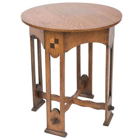 a lovely arts and crafts oak occasional table at 1stdibs
