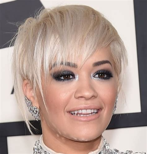 pixie crop with asymmetrical side swept bangs 20 gorgeous looks with pixie cut for round face