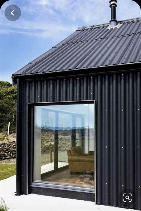 corrugated black metal vertical siding detail modern