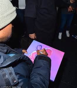 doodlebug rapper kanye west sketches fan s portrait at jfk airport daily