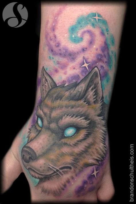 full hand wolf tattoo wolf hand tattoo by brandon schultheis tattoonow