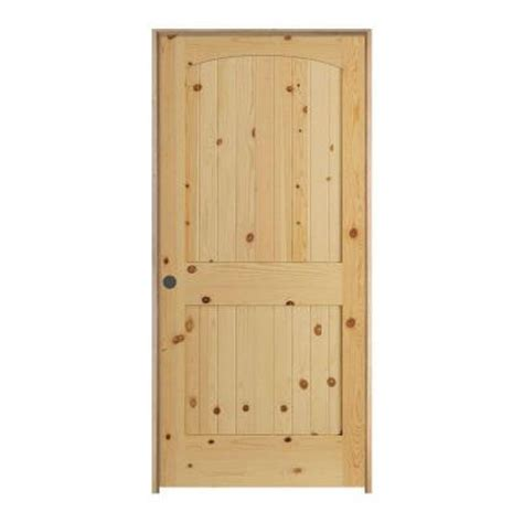 jeld wen woodgrain 6 panel unfinished pine single prehung jeld wen woodgrain 2 panel arch top v groove unfinished